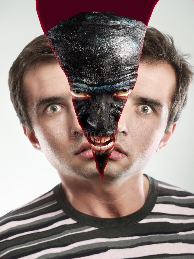 monster-inside-face-replacing-human-face-68376772